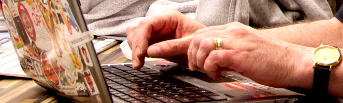 hands typing on keyboard, nice stickers, Bruce ;)